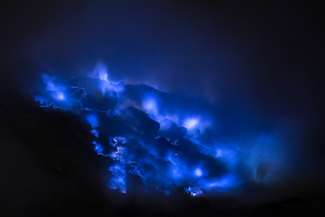 Blue sulphur flames at the Ijen Volcano are best viewed at night